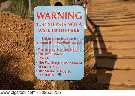 Warning Sign At The Base Of The Manitou Incline Hike In Colorado, Reminding Hikers That This Is A Di