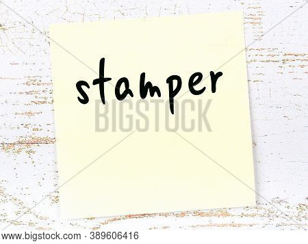 Yellow Sticky Note On Wooden Wall With Handwritten Inscription Stamper