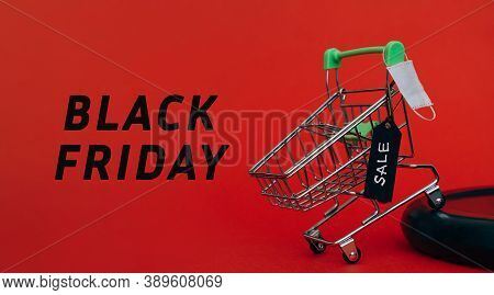 Shopping Cart With Black Label With The Inscription Sale On Red Background.miniature Protective Medi
