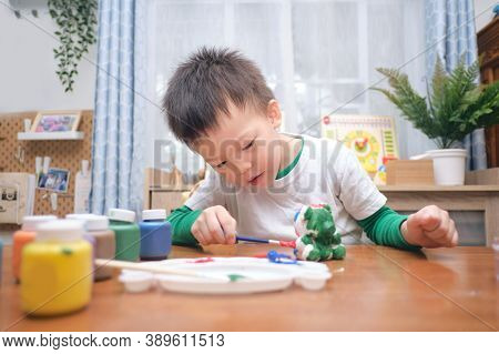 Cute Happy Little Asian 3 - 4 Years Old Toddler Boy Child  Painting Color On Diy Plaster Painting To