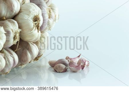 White Garlic Texture. Fresh Garlic Closeup. Spicy Cooking Ingredient Picture. White Garlic Head Heap