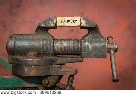 Concept Of Dealing With Problem. Vice Grip Tool Squeezing A Plank With The Word Slumber