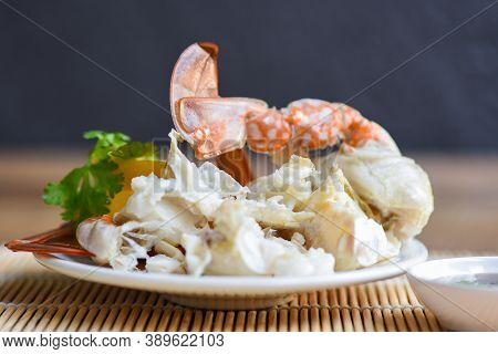 Crab Meat / Cooked Crab Claws And Legs On White Plate And Seafood Sauce On The Table , Blue Swimming