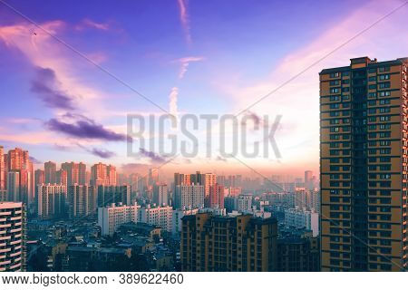 City Day Concept: Amazing Panorama View  City Skyline And Skyscraper At Sunset
