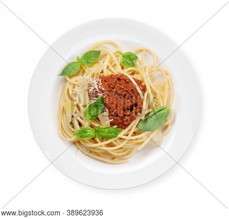 Spaghetti bolognese pasta with tomato and minced meat sauce, parmesan cheese and fresh basil. Top view flat lay isolated on white