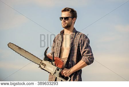 Brutal Worker Concept. Male Work Power Saw. He Fix Everything. Macho Man Chain Saw Tool. Comfident W