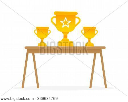 Wooden Table With Golden Trophies On It. Reward For Winner, Best In Competition. Championship Ceremo
