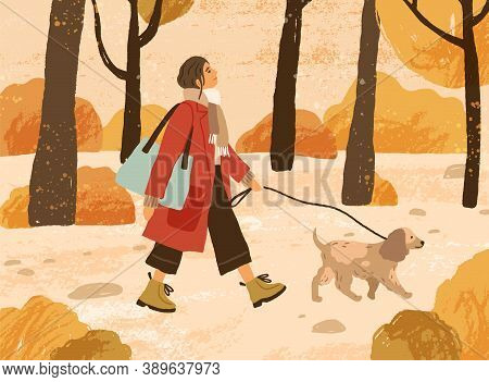 Young Woman In Trendy Warm Outwear Walking Dog In Autumn Park, Admiring Nature. Fashionable Female C