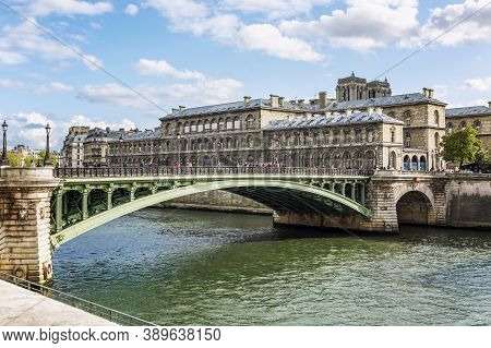 People Walking On The Bridge Over The Seine River. Paris, France, 09/10/2019.