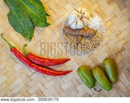 Close Up Various Kind Of Seasoning For Cooking. Garlic, Coriander, Chili, Turmeric, Blimbi, And Salt
