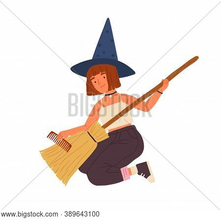 Cute Girl In Witch Hat Sitting And Combing Broom. Young Female Magician Or Wizard Portrait. Funny So
