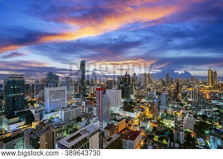 Bangkok City View From Roof Top Of Hotel Building With High Building And Sunset Sky Background.