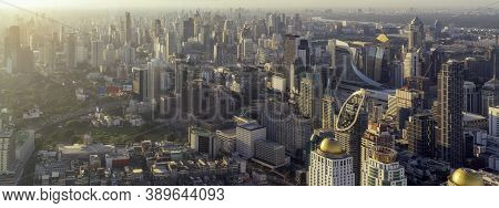 Ponorama For Cityscape Of Morning Sunrise In Bangkok City, Thailand With High Building And City