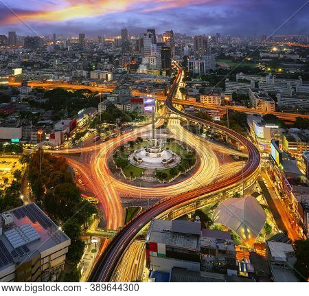 Victory Monument Thailand In Bangkok City With Sunset And Building Background, View Point From Rooft