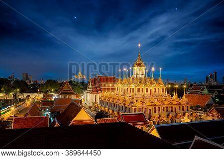 Wat Rajanaddaram Worawihan With Golden Pagoda Background In Bangkok City At Night, Bangkok, Thailand