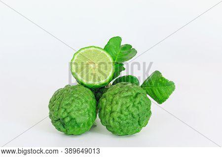 Green Fresh Bergamot Fruit  And Cut  Half With Leaf  On White Background.
