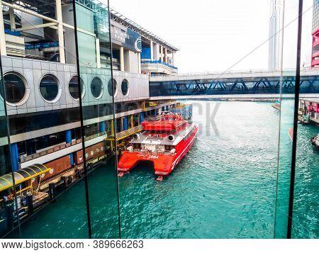 Macau, China - November 07, 2012: Macau Ferry Terminal And Red Turbojet, Speed Ferry Boat Running Be