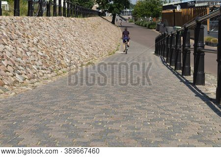 Descent On A Cobbled Path. Descent Down The Sidewalk