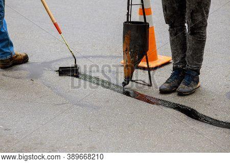 Sealing Joint Crack In Asphalt Road Surface Restoration Work Asphaltic Joint