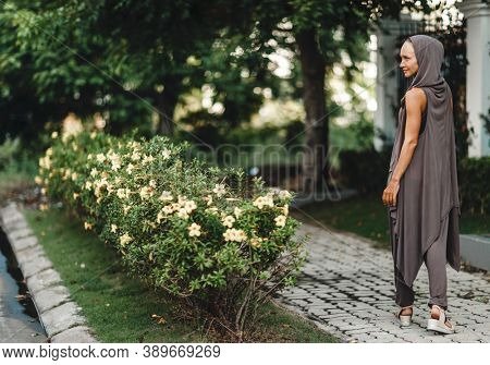 Fashion portrait of a beautiful woman outdoor