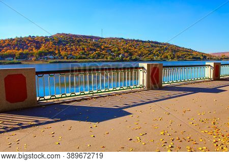 Autumn Leaves On The Waterfront With Balustrade
