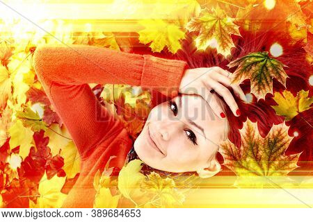 Autumn leaves light with girl. Beauty face of beautiful woman close. Fashion dream in red fall color outside. Happy person lights.