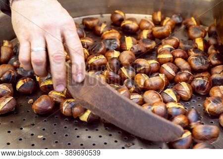 Chestnuts In A Pan During Charcoal Roasting At A Street Food Market. Charcoal Roasting Of Chestnuts