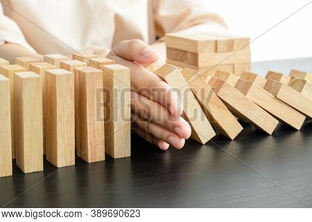Hands Of Businesswoman Stop Block A Wood Game, Gambling Placing A Wooden Block. Concept Risk Of Mana