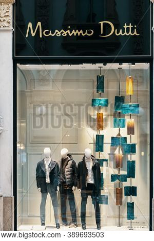 Massimo Dutti Logo And Showcase Of Luxury Fashion Shop In Milan. Three Male Mannequins Standing In S