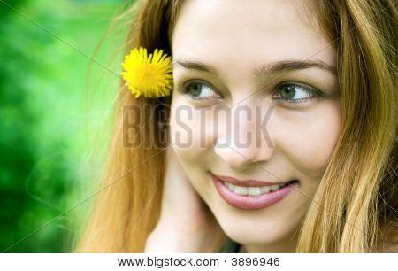 Portrait Of Attractive Girl In Green Field
