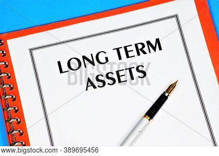 Long - Term Assets-text Label In The Document On The Planning Folder. Long-term Business Goals, Mark