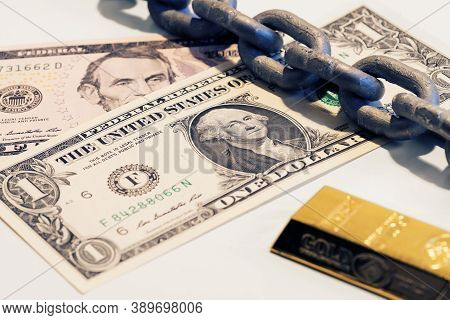 One And Five Dollar Bills, Bar Of Gold And Steel Chain. Money, Finance, Debt, Gold Standard And Depr