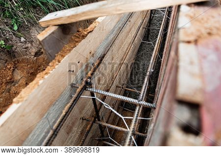 Timber Formwork With Metal Reinforcement For Pouring Concrete And Creating A Solid Foundation For A