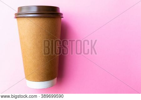 Brown Paper Coffee Cup On A Bright Pink Backgroud. Simple Flat Lay With Copy Space. Minimal Concept.