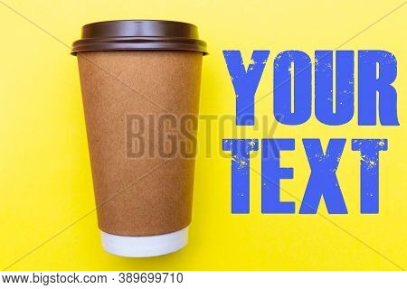 Brown Paper Coffee Cup On A Bright Yellow Backgroud. Simple Flat Lay With Copy Space. Minimal Concep