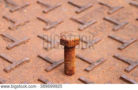 Rusty Metal Bolt Put On The Steel Plate Floor In Brown Color With Rusty Iron. Rust Is A Reddish Or Y