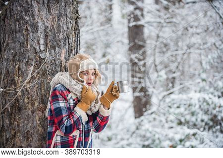 Woman In Hat Drinking Tea In Forest. Hiking And Traveling. Warm Yourself Up. Woman Winter Drink. Gir