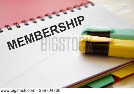 The Word Membership Is Written In A Notebook With Graphs Beside The Calculator. Member Login Members