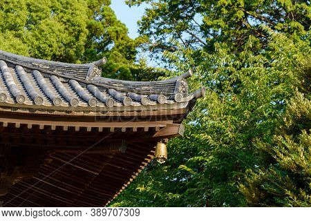 Close Up Of Traditional Japanese Temple Or Shrine Roof With Ancient Bell, Japan.
