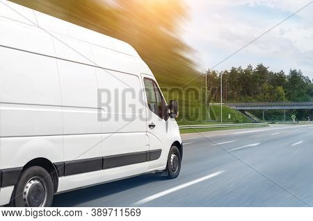 White Modern Delivery Small Shipment Cargo Courier Van Moving Fast On Motorway Road To City Urban Su