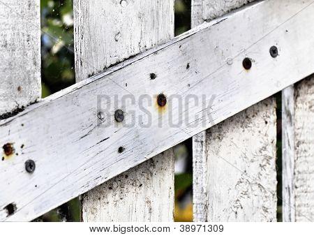 White derelict wooden door detail