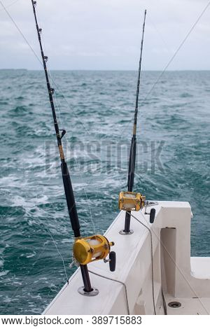 Two Fishing Rods On A Fishing Boat Charter In Varadero, Cuba For A Day Excursion Deep-sea Fishingon