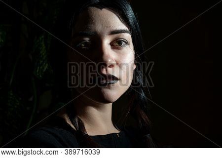 Goth Halloween Girl, In Black. Close-up Thematic Portrait Dramatic