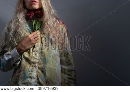 Sore Throat Concept. The Girl Holds Red Flowers At Her Throat. Sore Throat With Angina, Pharygitis,