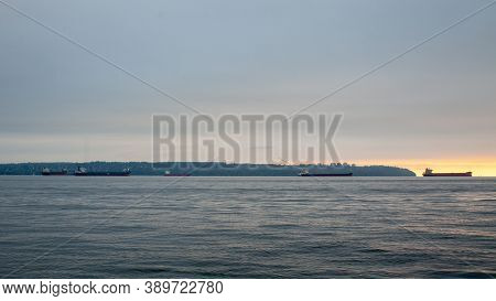 Looking At Vancouver (kitsilano And Ubc) From The North Shore At Sunset, With Freighters On The Wate