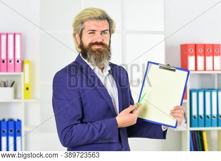 Business People Concept. Bearded Man Making Notes. Confident Businessman Holding Documents. Business