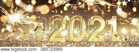 Happy New Year 2021. Golden Background with Sparklers and Confetti