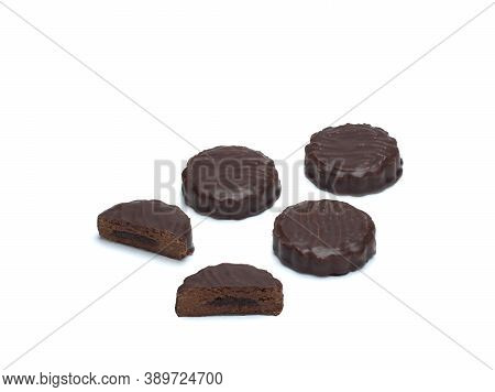 Top View Of Chocolate Biscuits Filled With Biscuit Crumbs And Condensed Milk And Cocoa Isolated On W
