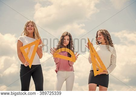 High School. Three Girls With Protractor And Triangle Ruler. Back To School. Stem School Disciplines