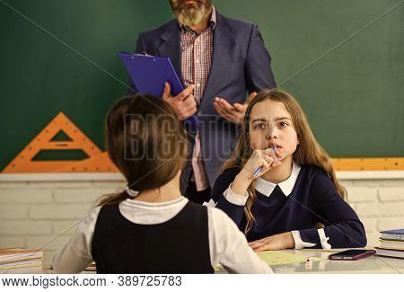Help And Support. Children And Teacher. Pedagogue. Watching Them. Teacher And Kids Classroom. Focuse